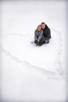 Winter engagement pictures put some colourful rose petals or something in the snow