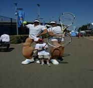 Tennis themed entertainers for hire in London and the UK. Comedy stilt walking Tennis players.