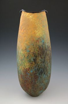 Melanie-Ferguson-18inch-tall-hand-built-low-fire-underglaze-and-beeswax..jpg 450×687 pixels
