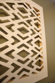 DIY cut canvas art. Stencil or draw pattern/image to back of canvas. Cut out with Exacto knife. Leave white or paint (make sure to paint inside frame to match). Think this would also be cool to add paper, fabric, maps, photos, etc. to the back instead of just having the wall show through.