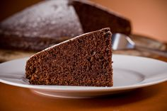photo of delicious chocolate cake on wooden table