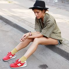 Hat and New Balance sneakers. Trop Rouge.