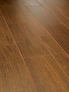 I think these new wood looking tiles are so awesome!  Crossville Wood Impressions in Gunstock