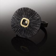 """R M Studio Jewelry - Sand Dollar Ring Top 3/4"""" across. Band width 1/8"""" Oxidized sterling silver, 18k gold and .04ct natural diamond."""