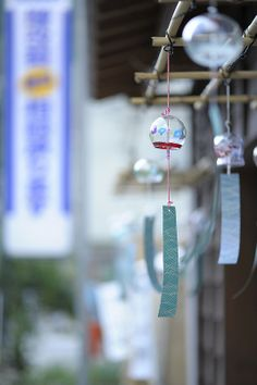 風鈴 - a Furin; literally a wind bell(chime), a Japanese hanging bell made to tinkle in the wind and give people a feeling of relief from the heat of summer days.