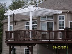 The ultimate deck! Has the Double Beam Attached Pergola on an elevated deck.