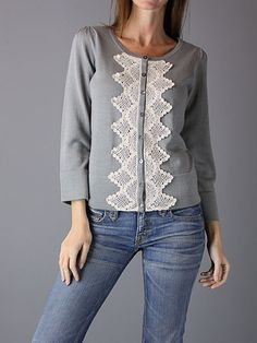 This would be easy to make with a plain sweater and the right lace!