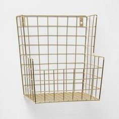 Organize your little one's toys and accessories with the Decorative Wall Hanging Basket from Pillowfort™. Made with a sturdy wire metal frame, this wall-mounted basket features a rectangular shape with a low front and high back to keep your little one's items neatly tucked away and easily accessible. Simple and stylish, you can hang this multifunctional storage basket in a play area or anywhere that your little one has a lot of toys laying around that need to be organized and...