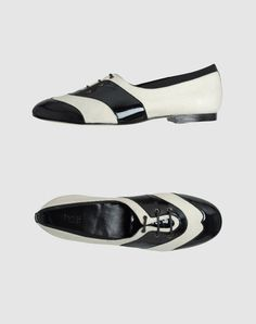laced black and white oxfords by Hoss Intropia