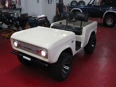Early Square-Body Bronco golf cart.