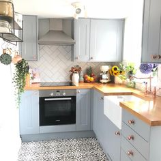Sorry but how cute is this little country style kitchen? Such a simple space but so tastefully done. Small Galley Kitchens, Galley Kitchen Remodel, Grey Kitchens, Kitchen Reno, New Kitchen, Kitchen Dining, Kitchen Cabinets, Kitchen Ideas, Butcher Block Countertops