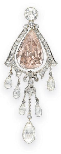 A BELLE EPOQUE COLORED DIAMOND BROOCH Centering upon a bezel-set pear-shaped fancy brownish pink diamond, weighing approximately 5.83 carats, within an old mine-cut diamond scalloped surround, topped by a bezel-set old European-cut diamond, the bottom suspending briolette-cut diamond drops with single-cut diamond foliate detail and and collet-set diamonds, mounted in platinum, circa 1910.