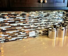 Love this backsplash, I'd rather border it with natural stone for more contrast though