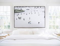 Bright bedroom with large art over the bed