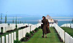 An Australian wearing a First World War uniform walks past graves at the Australian War Memorial in Villers-Bretonneux on Anzac Day. Photogr...