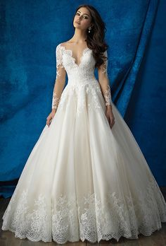 Brides: Allure Bridals. Inspired by royalty to design this long sleeved ball gown.