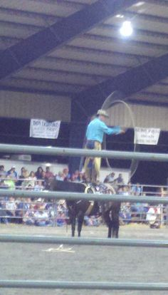Guy did some awesome rope tricks on his horse.