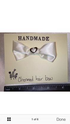 Ivory charmed hair bow, with heart shaped charm. FREE SHIPPING!!! #bunnyrootsbows