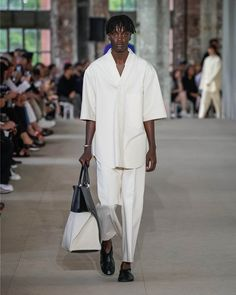 See all the Collection photos from Jil Sander Spring/Summer 2020 Menswear now on British Vogue