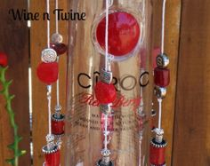 This is an original, one-of-a-kind wind chime. Made from a recycled blue and silver Three Olives Vodka bottle, Tom has added a ring top which a mixture of beads, baubles and charms hanging down to create a lovey sound for any backyard or patio. Thank you for stopping by our shop! Tom and Diane