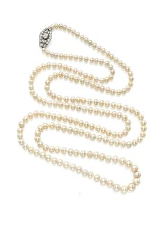 A single strand natural pearl and diamond necklace