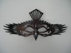 This Corvid inspired mask is created from a top grade 3 oz. vegetable tanned tooling leather, this raven mask is hand cut, carved, formed. I use no