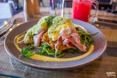 Herb crumbed poached eggs with serrano ham, a chive and potato rosti and hollandaise at Hardware Store Cafe