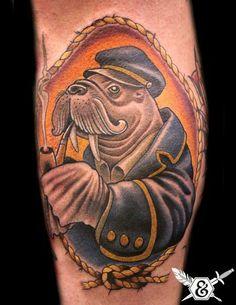 This sea captain/walrus was tattooed by Russ Abbott. #InkedMagazine #seacaptain #walrus #animal #tattoo #tattoos #Inked #Ink