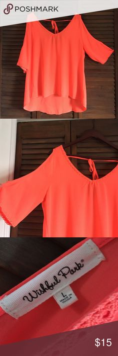 🆕 Bright Orange Cold Shoulder Top 🚫 NO TRADES🚫 EUC. Size L. Relaxed fit. Worn twice. Bright orange cold shoulder top. Open back with a tie. No stains, runs, or tears. OFFERS ARE WELCOMED 😊 Wishful Park Tops