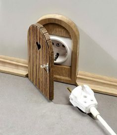 I simply must have a mouse hole cover for every outlet in my dream home! Ahhh cute :D