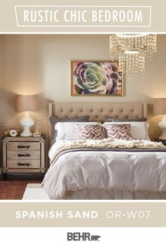 This glam-chic master bedroom is full of bold interior design choices. Our favorite is the painted brick wall featuring BEHR® Paint in Spanish Sand. This classic neutral wall color gets a modern twist when paired with home decor elements like the tufted headboard, hanging chandelier, and fun wall art. Click below to learn more.