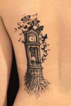 See more Big Wall clock and flying butterfly tattoo on back body