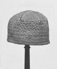 Cap (headgear) | | V From Egypt, ca 1250-1500 AD  Cap is woven silk and linen. Fabric is blue silk. Early quilting, like the Tristan and Isolde quilt