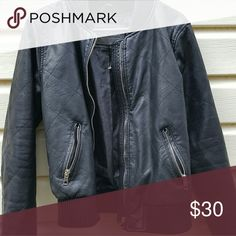 Ci Sono by Cavalini Leather Jacket This is a black faux leather jacket. Its brand new, never worn. I dont have the tag but it has the plastic tag on it still. The tag was on it before i took the picture but was only half so i ripped it off.  All the zippers are shiny and silver except the front zipper one. I have included a picture.  In all honesty this was a gift so im not even sure if its real leather or not. Ci Sono Jackets & Coats