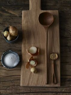 natural cutting board & spoons on wood