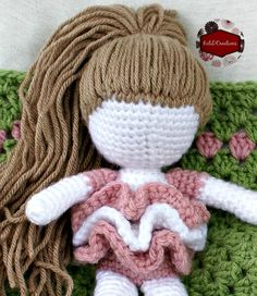 After completing the doll I was wondering how to do the yarn for her hair.  I knew I did not want to take the time to put hair around each post, it just seemed that there would be so much and possibly difficult to style.  Plus knowing myself, I would obsess over getting the hair …