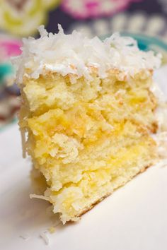 Lemon-Coconut Cake. Lemon curd, flaky coconut. Your tastebuds will thank you from here to eternity:)