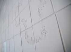 Wall of tex-tiles, two are back lit #tiles #transparant #white #translucent #porcelain #15x15 #bathroom #textiles #wall #decoration #led #imprint #relief #barbaravos #wallcovering #kitchen #shower #home #interior #design #glaze #backsplash #flower #pattern #coral #fabric #lace