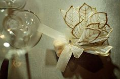 Jordan Almonds Wedding Favors: The perfect tone for a fall wedding! Italian tulle and embroidered leaf organza. Available from Etsy vendor bridalfrenchlace, 25 for $75.