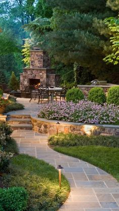 I love the way walkway incorporates the raised bed to a platform with fireplace too. Nice that the creeping vines and trees serve as more of a privacy cocoon..
