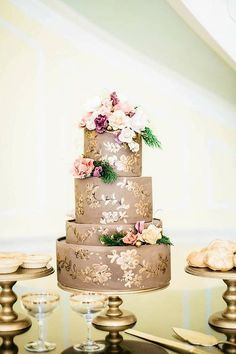 I adore the muted gold on this cake with the shiny accents!