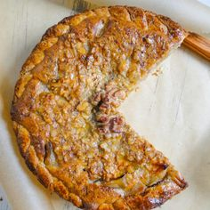 rustic pie with an almond crust and rum soaked apples with a walnut ...