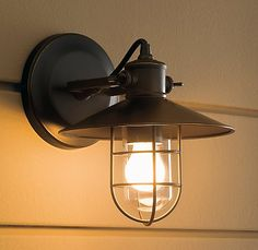 Wall-mounted exterior sconce. Available in bronze finish