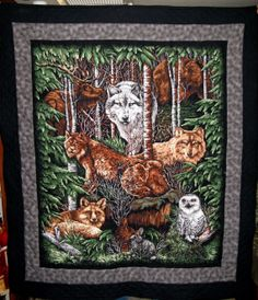 "This forest animals lap quilt measures 44""x50"" and sells for $75"