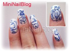 blue and white dutch nails clog windmill bunny bird tulip