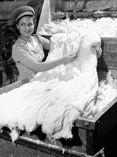 Female worker handles asbestos fluff in an asbestos factory. Hard to believe in these times...