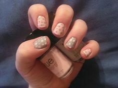 Cute short nail design. Pink and grey polka dots.