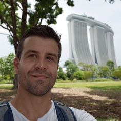 In the foreground: My face.  In the background: Marina Bay Sands.  At a cost of 5.7 billion it is the most expensive building project ever completed. I am on my way to Nepal with no plan, other than the intention to make Asia the fourth continent I've built on. Not sure if I can match the marina bay sands but god damn it I'll try!  If you want to see how It works out then check out scottbrowncarpentry.com  In the mean time; I just survived a Malaysian Airlines flight! Malaysian Airlines, Airline Flights, My Way, Carpenter, Continents, Marina Bay Sands, Nepal, Asia, Survival