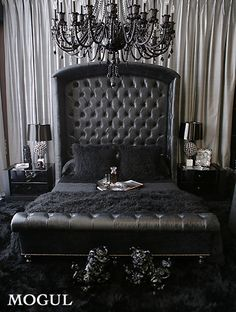 Rock Star Bedroom.  I like the draped wall behind the bed...and of course the chandelier.
