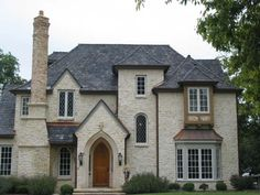 Love the slate roof and the stone exterior, the arch entry is perfect. I want the house plans!!!